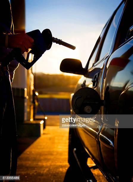 Gas pump filling up a car.