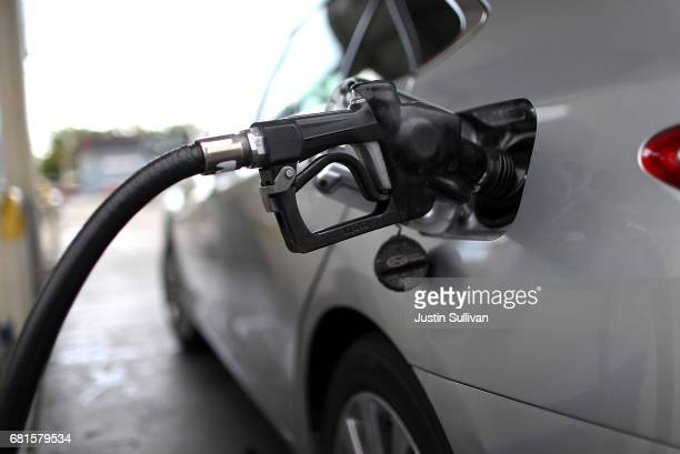 A gas pump fills a car with fuel at a gas station on May 10 2017 in San Rafael California California Gov Jerry Brown is set to announce his revised...