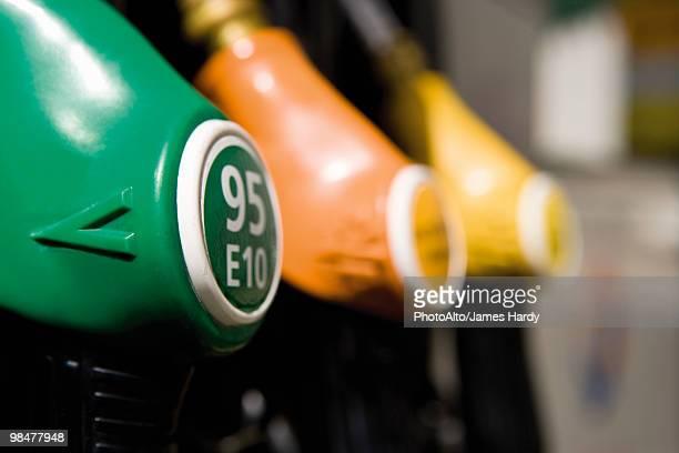 Gas pump nozzles in a row
