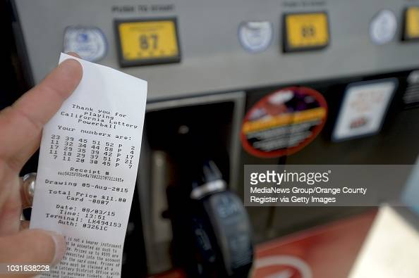 A gas pump receipt shows lotto numbers purchased at the pump while