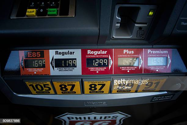 A gas pump reflects cheaper gas prices February 12 2016 in Oklahoma City Oklahoma Earlier this week gas stations were posting cheaper prices many...