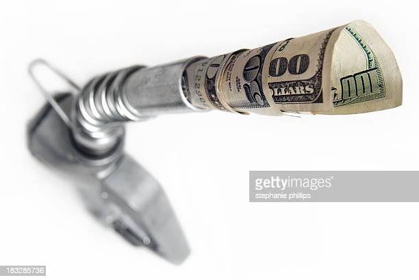 Gas Pump with Cash Coming Out of the Nozzle