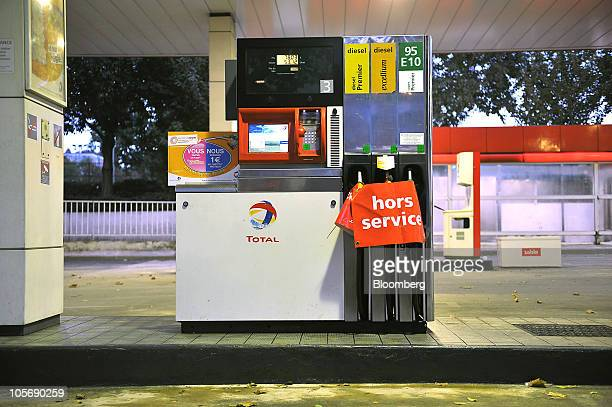 Gas pumps with no fuel sit cordoned off at a Total gas station in Paris France on Tuesday Oct 19 2010 French unions stepped up pressure on President...