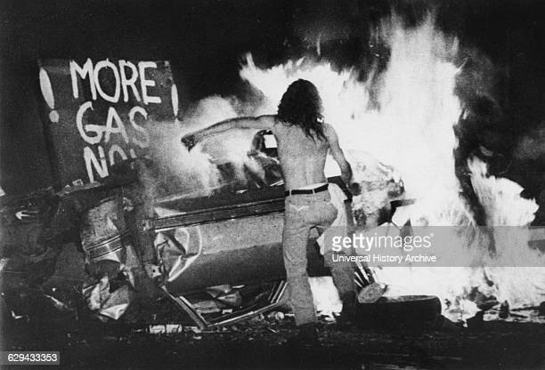 Gas Shortage Demonstrator in Front of Burning Car During Riot at Night Levittown Pennsylvania USA 1979