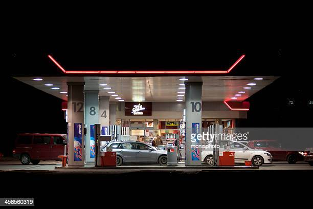 gas station at night - convenience store stock photos and pictures
