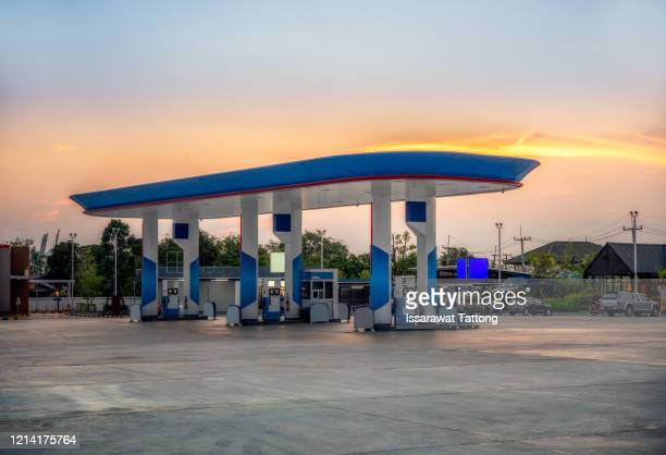 gas station at sunset. - gas station stock pictures, royalty-free photos & images