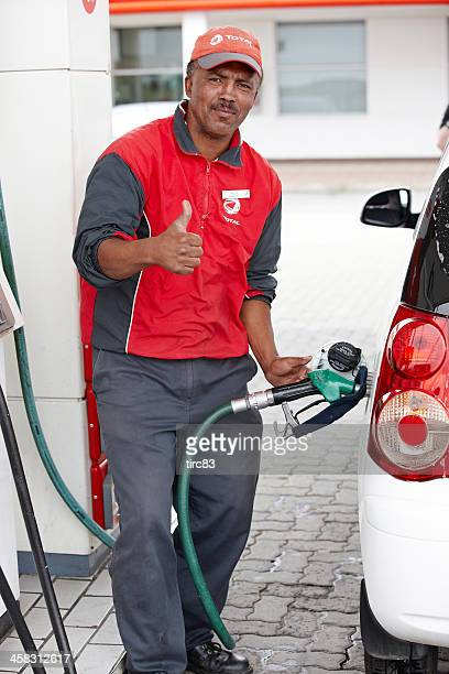 Gas station attendant giving thumbs up