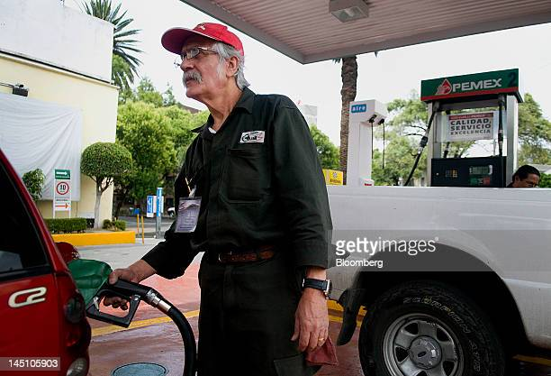 Gas station attendant Javier Meazas pumps fuel at a Petroleos Mexicanos service location in Mexico City Mexico on Sunday May 20 2012 Yields on...