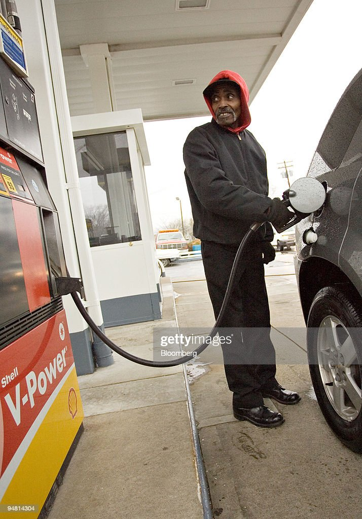 a gas station attendant pumps gas at a service station in millburn new jersey