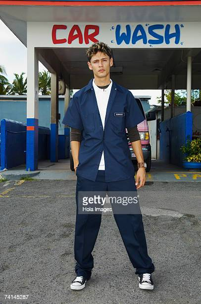 Gas station attendant standing in front of Car Wash