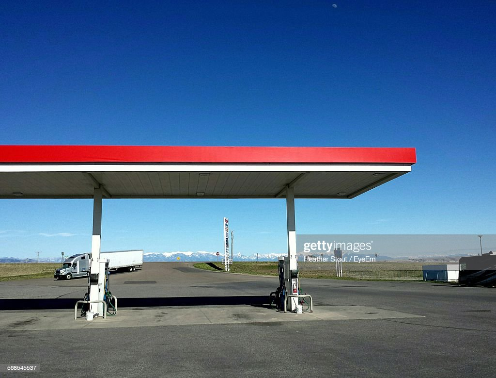 Gas Station By Road Against Clear Blue Sky : Stock Photo