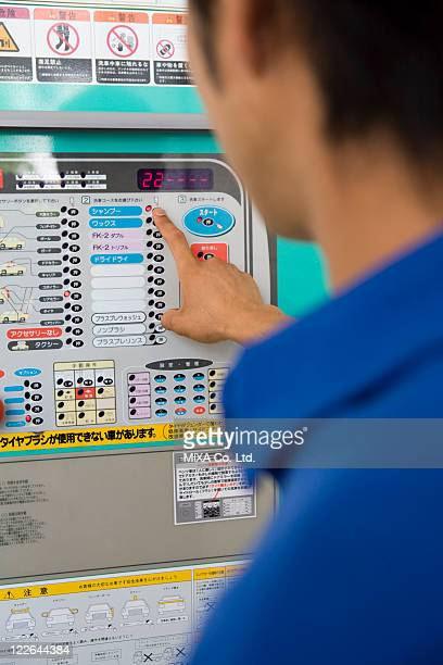 Gas station clerk operating machine
