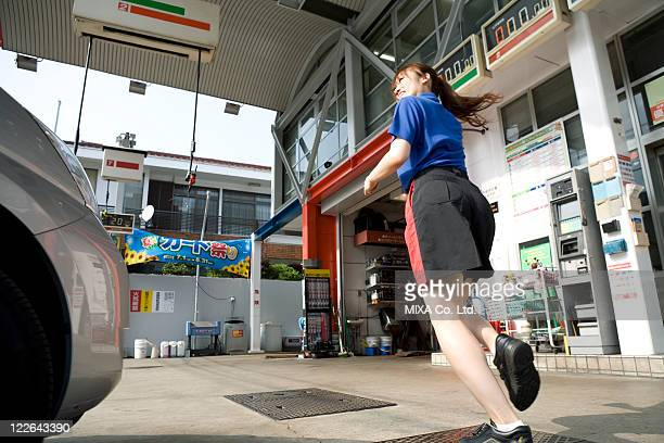 Gas station clerk running