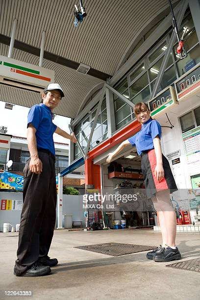Gas station clerk standing