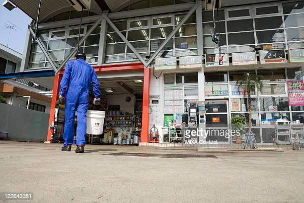 Gas station clerk walking