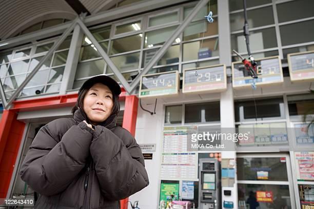 Gas station clerk wearing down jacket