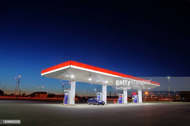 gas station exterior night lights - garage stock pictures, royalty-free photos & images