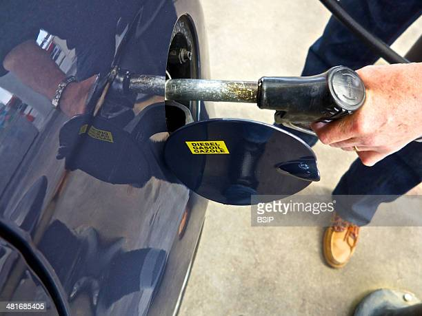 Gas station filling up a car with fuel