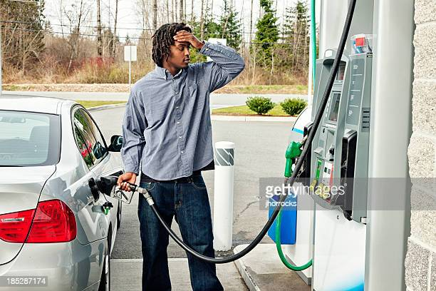 gas station frustration - petrol stock photos and pictures