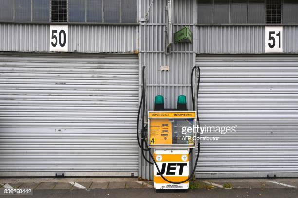 A gas station in the old paddock of the Nuerburgring near Adenau western Germany on August 21 2017 / AFP PHOTO / PATRIK STOLLARZ