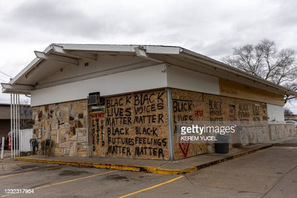 Gas station is boarded up after the previous night's unrest near the Brooklyn Center police station in Brooklyn Center, Minnesota on April 14, 2021....