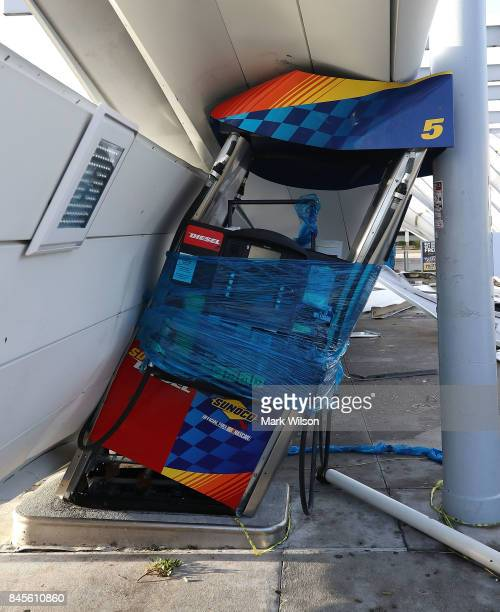 A gas station is shown damaged by Hurricane Irma winds on September 11 2017 in Bonita Springs Florida Yesterday Hurricane Irma hit Florida's west...