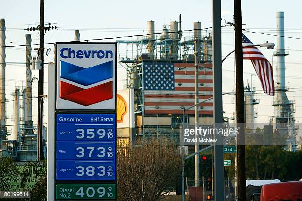 A gas station near the British Petroleum Arco Wilmington refinery advertises its gas prices after oil hits another new record at $109 a barrel on...