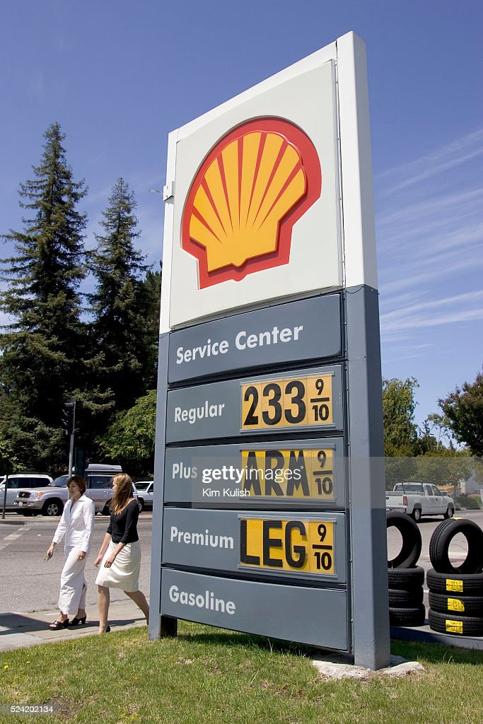 A gas station price sign in reflects the frustration of record high
