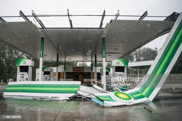 A gas station shows wind damage on September 5 2019 near Pawley's Island South Carolina Hurricane Dorian spins just off shore of the state and is...