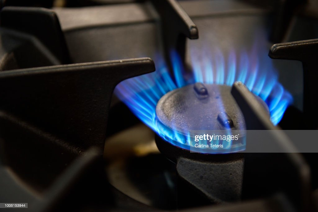 Gas stove burner with blue flame : Stock Photo