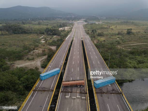 A gas tank and shipping containers obstructing passage to Venezeula are seen on the Tienditas International Bridge in an aerial photograph taken over...