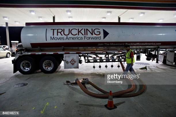 A gas tanker truck delivers fuel to a gas station in Estero Florida US on Tuesday Sept 12 2017 Seven million utility customers across the US...