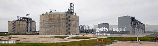 Gas tanks are seen at the Freeport LNG facility in Quintana Texas US on Wednesday April 1 2009 This facility boasts two gigantic LNG tanks that can...