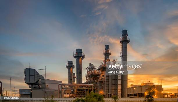 gas turbine electrical power plant at dusk with twilight support all factory in industrial estate - power station stock pictures, royalty-free photos & images
