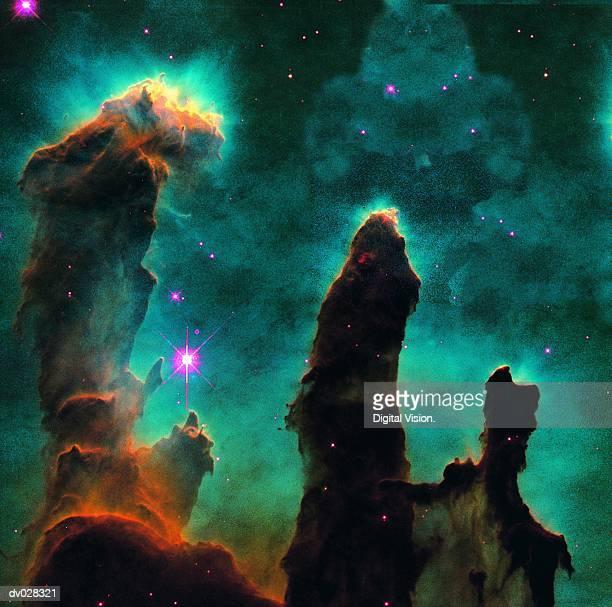 gaseous pillars in the eagle nebula - nevels en gaswolken stockfoto's en -beelden