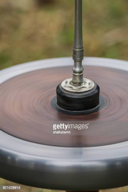 """""""gasing"""" or tops spinning, is a traditional games popular among malay in malaysia. - shaifulzamri fotografías e imágenes de stock"""