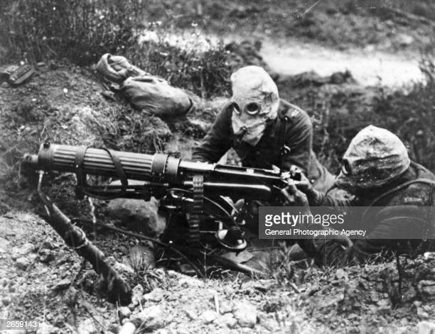 Gasmasked men of the British Machine Gun Corps with a Vickers machine gun during the first battle of the Somme