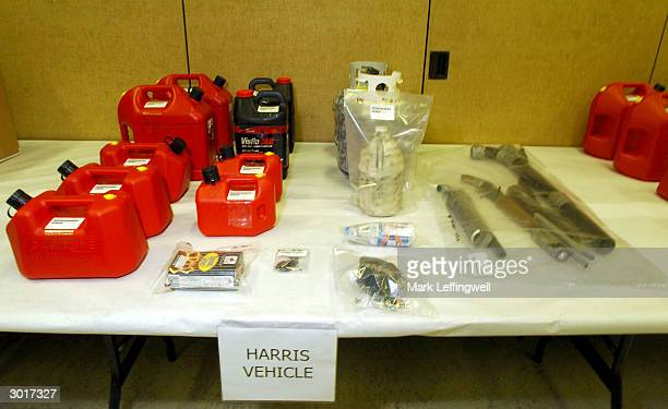 Gasoline canisters a propane tank bleach and homemade weapons collected from Eric Harris's vehicle are shown on display at the Jefferson County...