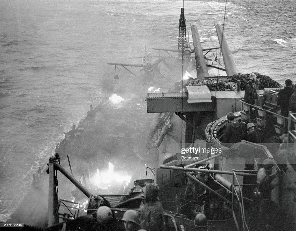 USS Nevada Smoking Due to Airplane Crash : News Photo