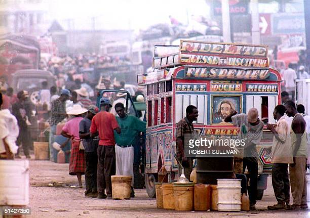 Gasoline is sold on the black market for about 9USD per gallon 26 May 1994 in a section of Port Au Prince Haiti known as Kuwait City Dominican...