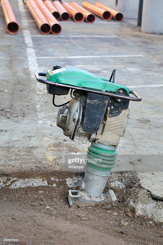 Gasoline or diesel vibratory plate compactor : Stock Photo