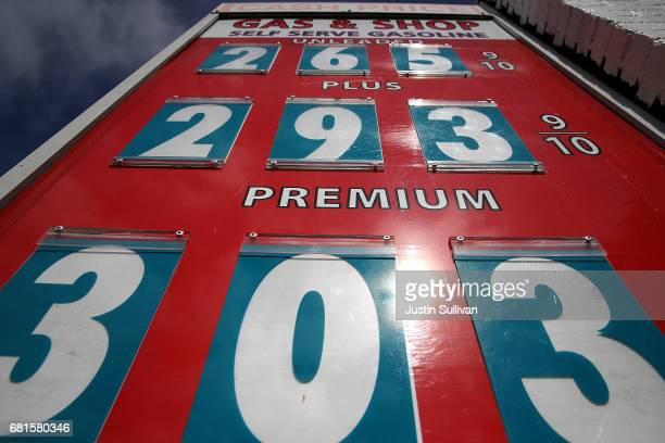 Gasoline prices are displayed at a gas station on May 10 2017 in San Anselmo California California Gov Jerry Brown is set to announce his revised...