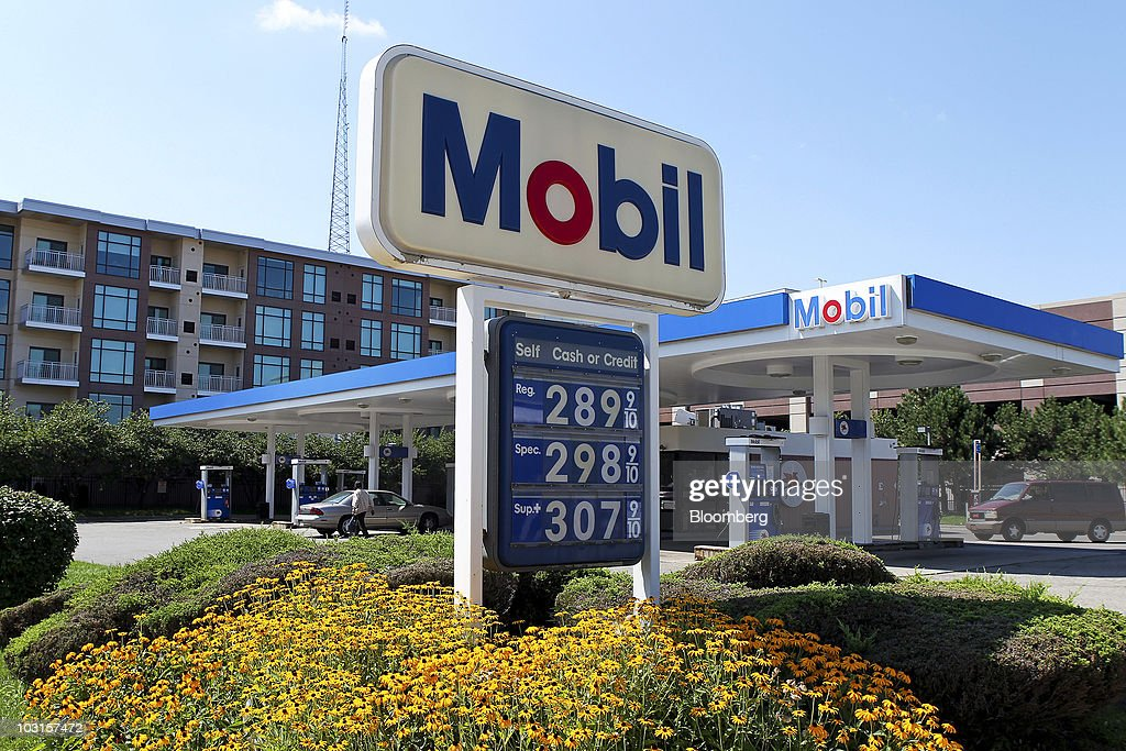 Gasoline prices are displayed at a Mobil gas station in