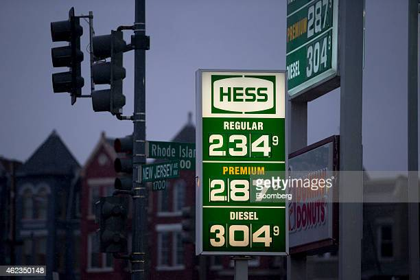 Gasoline prices are displayed on a sign at a Hess Corp gas station in Washington DC US on Monday Jan 26 2015 Hess Corp is expected to report...