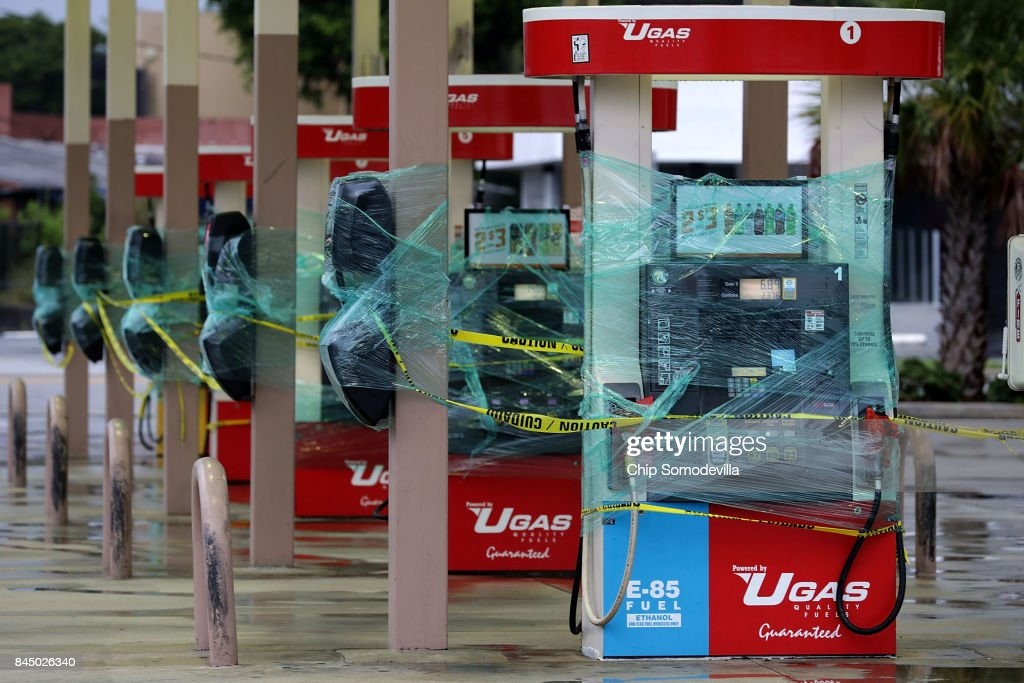 Gasoline pumps are wrapped in plastic ahead of the arrival of Hurricane Irma September 9, 2017 in Fort Lauderdale, Florida. Governor Rick Scott has ordered an evacuation of millions of people from the southern part of the state ahead of the unprecedented storm.