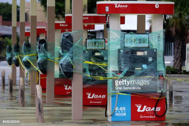 Gasoline pumps are wrapped in plastic ahead of the arrival of Hurricane Irma September 9 2017 in Fort Lauderdale Florida Governor Rick Scott has...