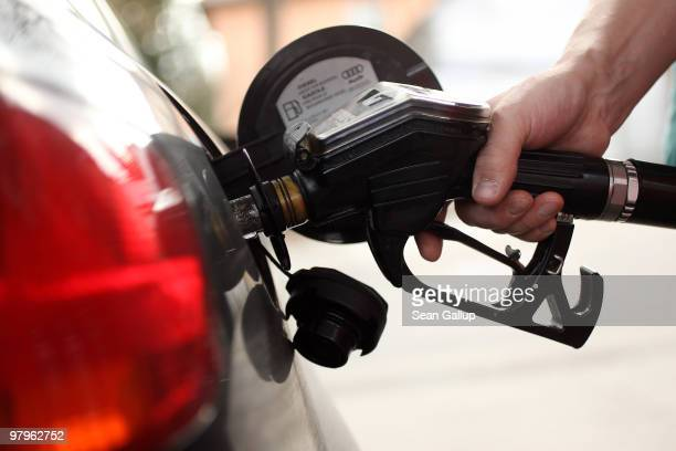 A gasoline station attendant pumps diesel into a car at a filling station on March 23 2010 in Berlin Germany German President Horst Koehler said on...