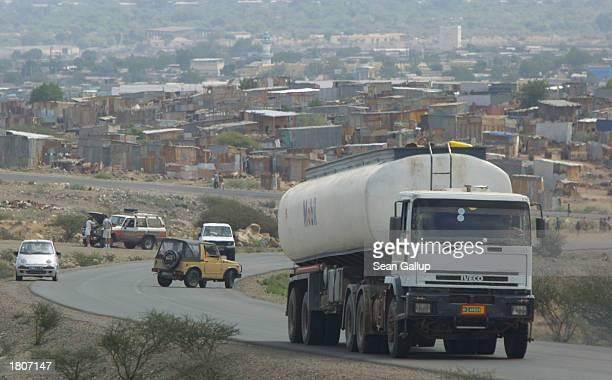 A gasoline tanker drives by the BaalBalla slum February 21 2003 in the outskirts of Djibouti Town Djibouti Djibouti is the main port for shipments of...