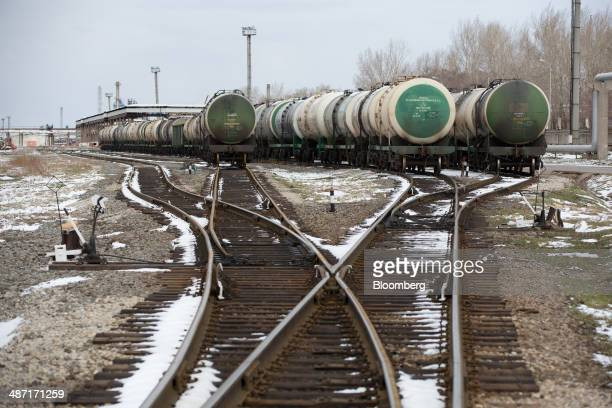 Gasoline tankers stand on railway tracks at an oil refinery operated by OAO Bashneft in Ufa Russia on Friday April 25 2014 Bashneft controlled by...