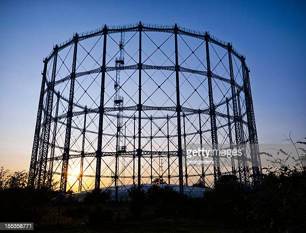 gasometer at sunset - storage tank stock photos and pictures